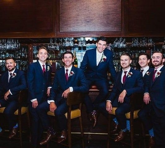 formally modern tuxedo Ross Werner & Groomsmen in Navy Suits